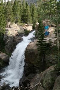 Jamie standing next to Albertia Falls in Rocky Mt. Nat. Park