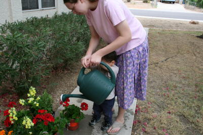 Jamie and Nathan watering the flowers before planting.