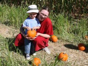 Nathan picks his pumpkin to bring home.