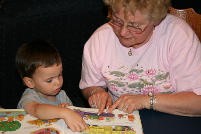 Nathan shows Grandma one of his favorite books.